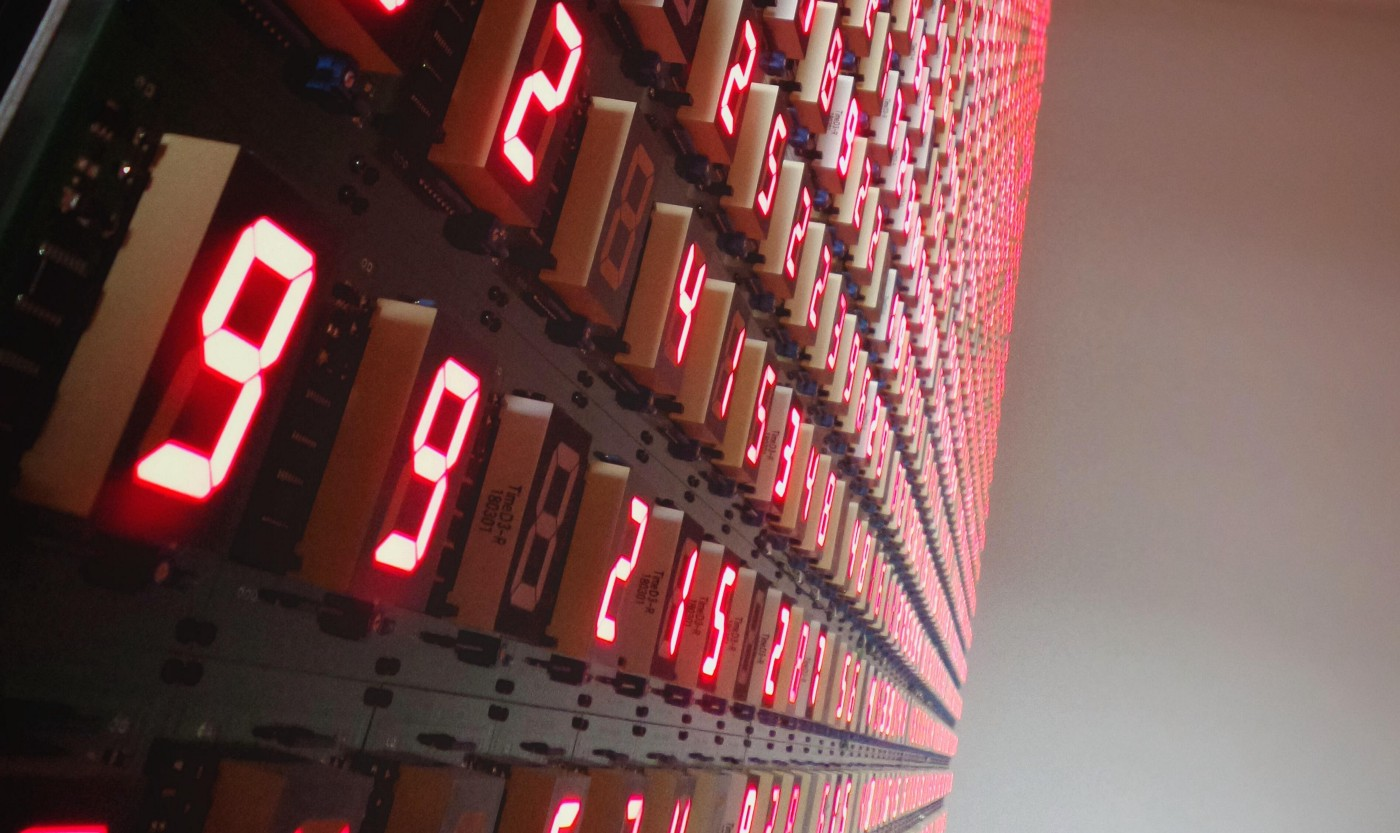 neon display of strings of numbers