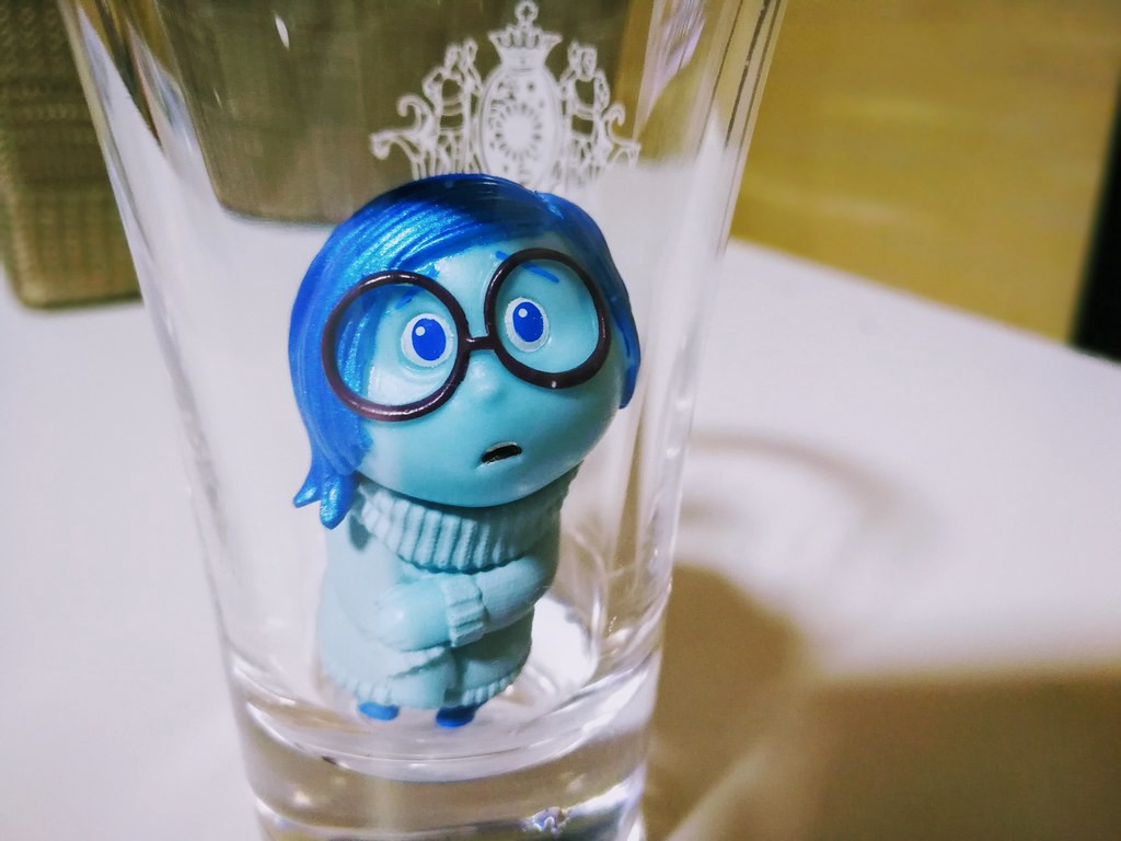sadness from the pixar film inside out looks at the camera sadly