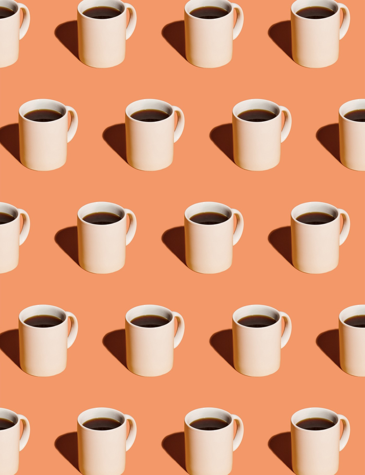 A photo of coffee cups lined up.