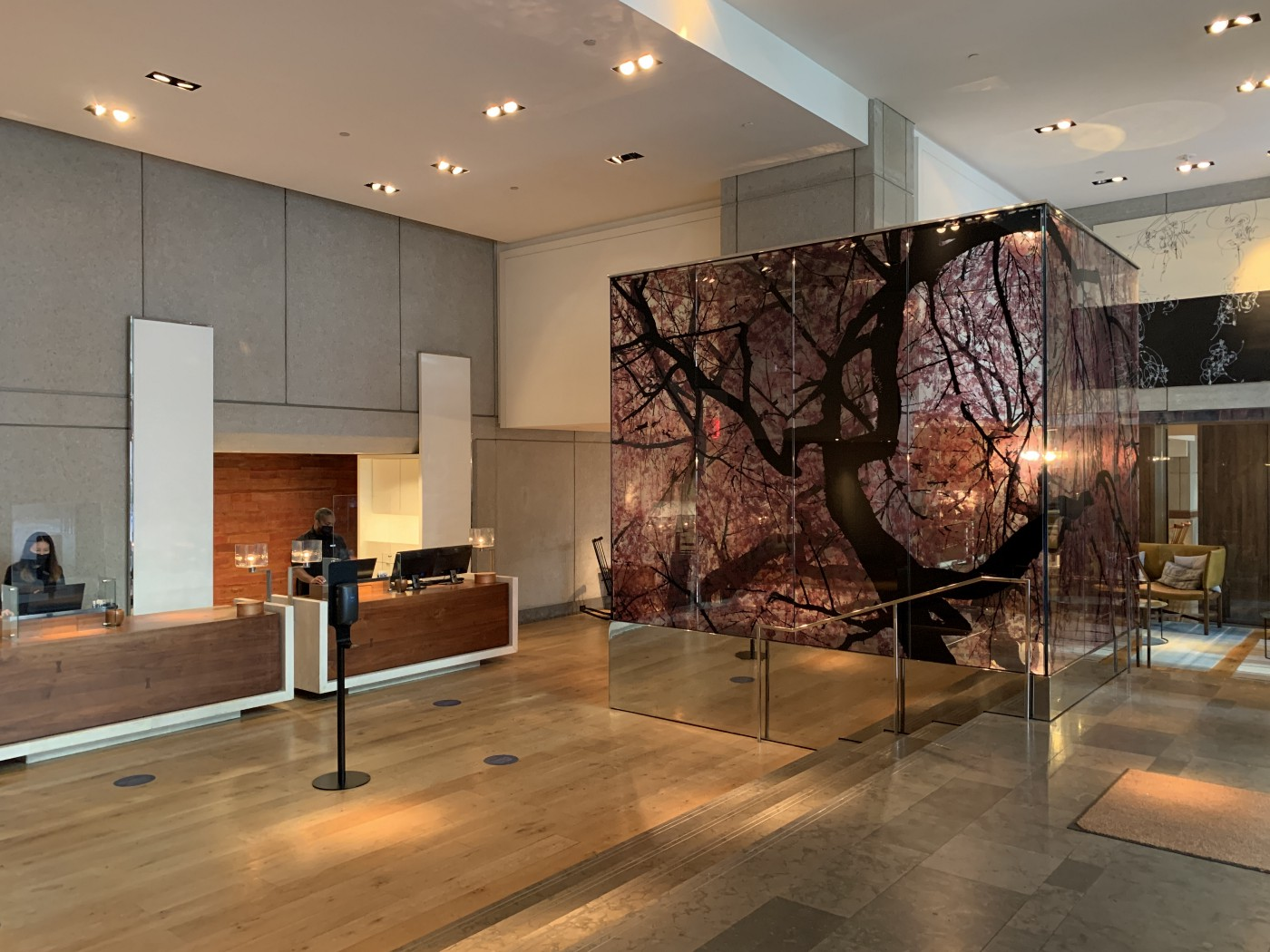 Park Hyatt Washington D.C.'s lobby and front desk which has a painting of a cherry blossom tree on glass.