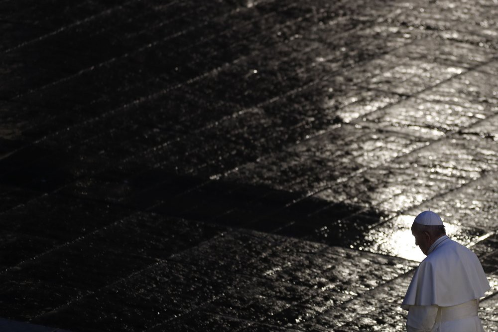 Pope Francis walks in the rain outside St. Peter's Square this spring to celebrate outdoor Mass during the pandemic.