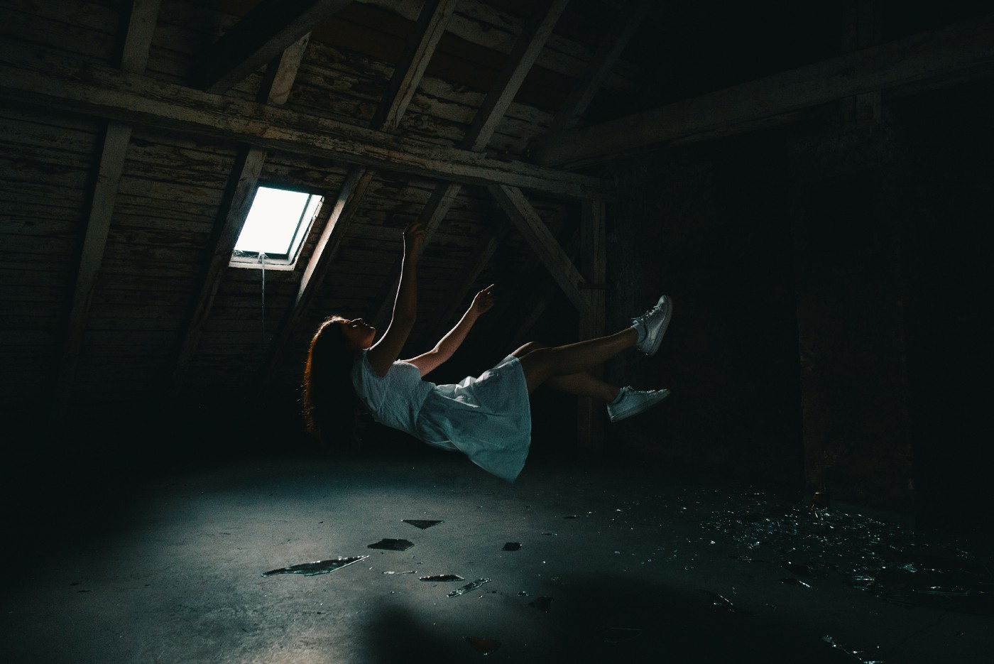 A 'trippy' capture of a woman falling backwards, but at the same time, seemingly floating in the air with a quality of otherworldliness.