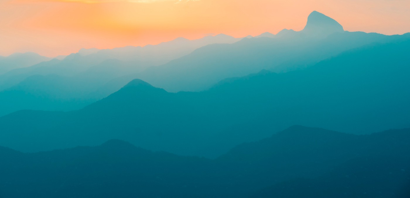 """Stylish photo of mountain tops in different colours, symbolising """"layers""""."""