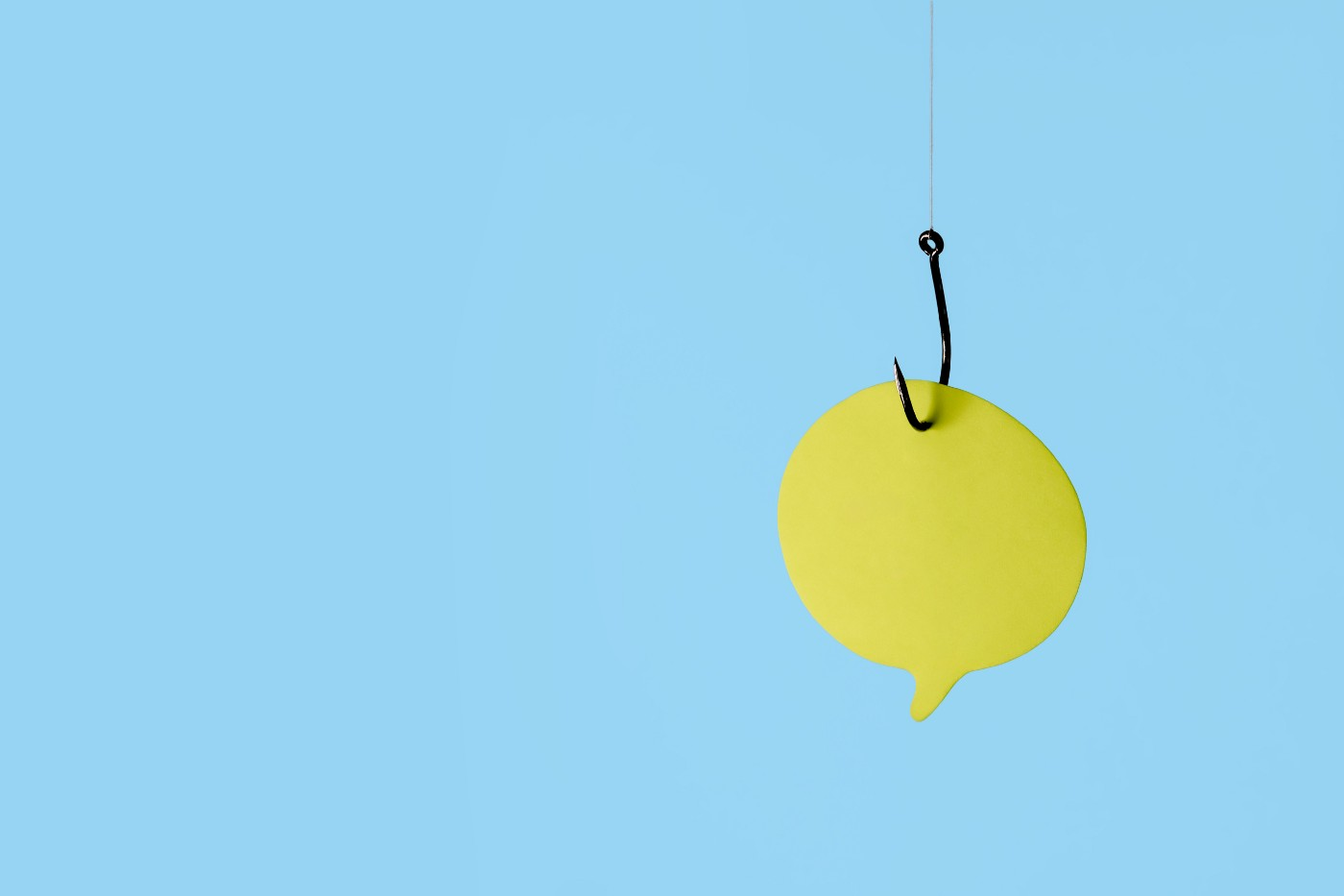 A yellow paper quote bubble on a fishing hook with a blue background.