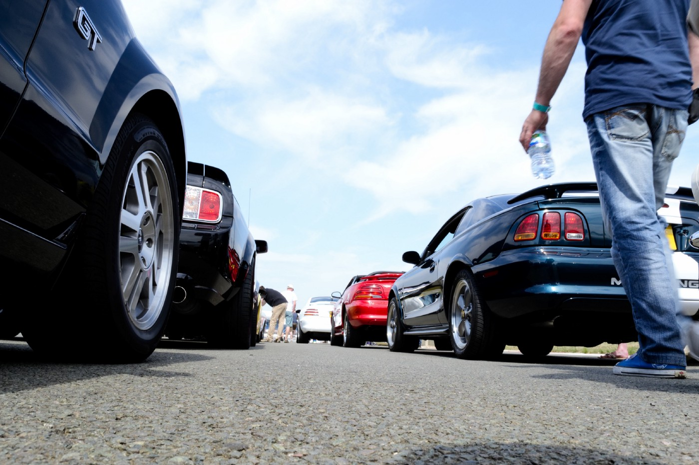 A queue of Ford Mustangs