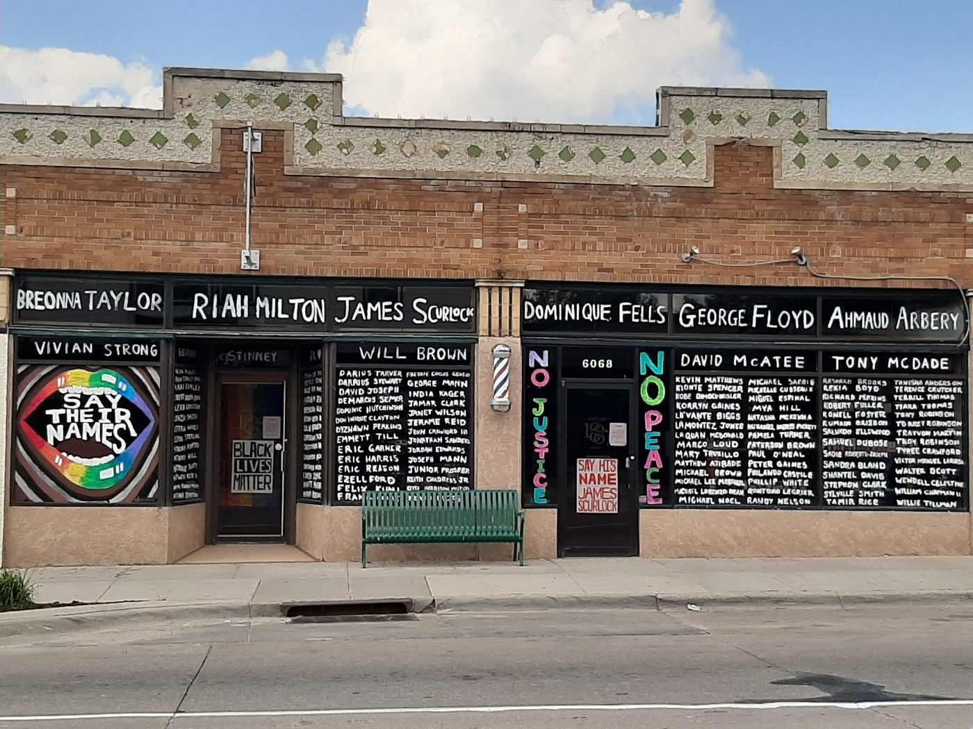 Image of more than 100 names of slain Black people on storefront windows in Benson Business District, Omaha, NE, July 4, 2020