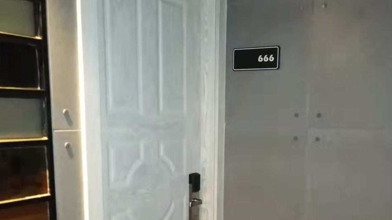 Three lucky sixes outside of a door