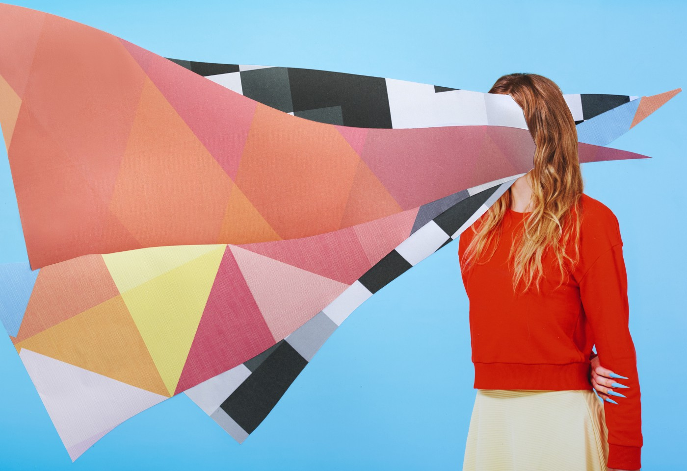 A photo of a woman with paper collage going through her head.