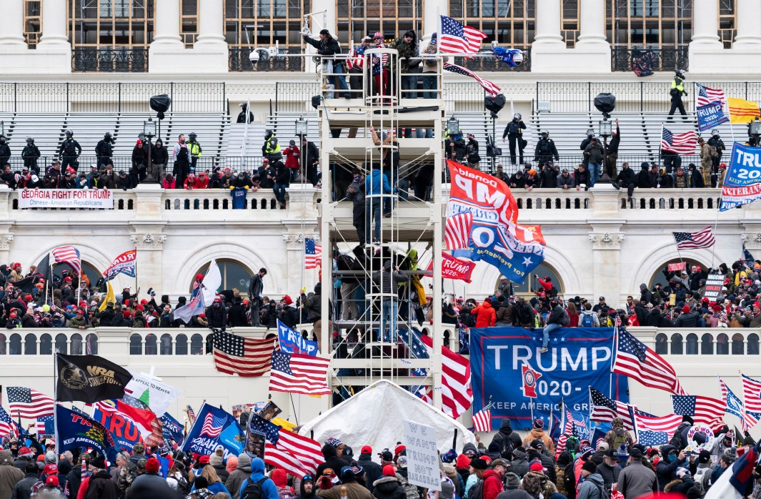 Trump rioters occupy the West Front of the Capitol and the inauguration stands on Jan. 6, 2021. (Bill Clark/CQ Roll Call)
