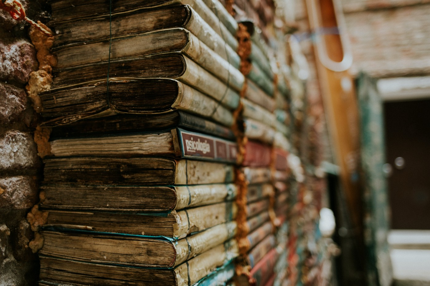 Pile of old books in a dusty room