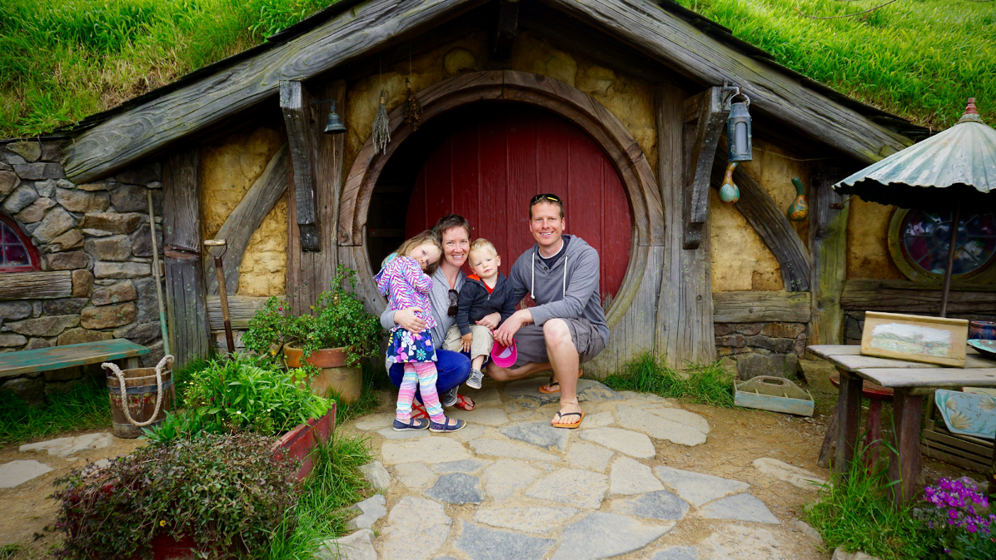 My little family or four in front of the Hobbit house in New Zealand.
