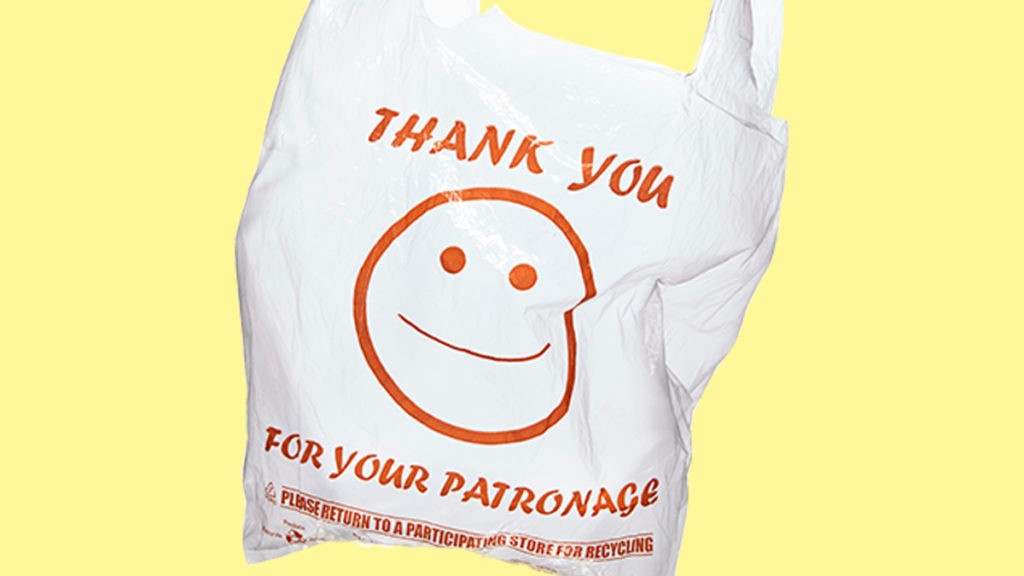 "A disposable shopping bag printed with a smiling face and the message ""thank you for your patronage"""