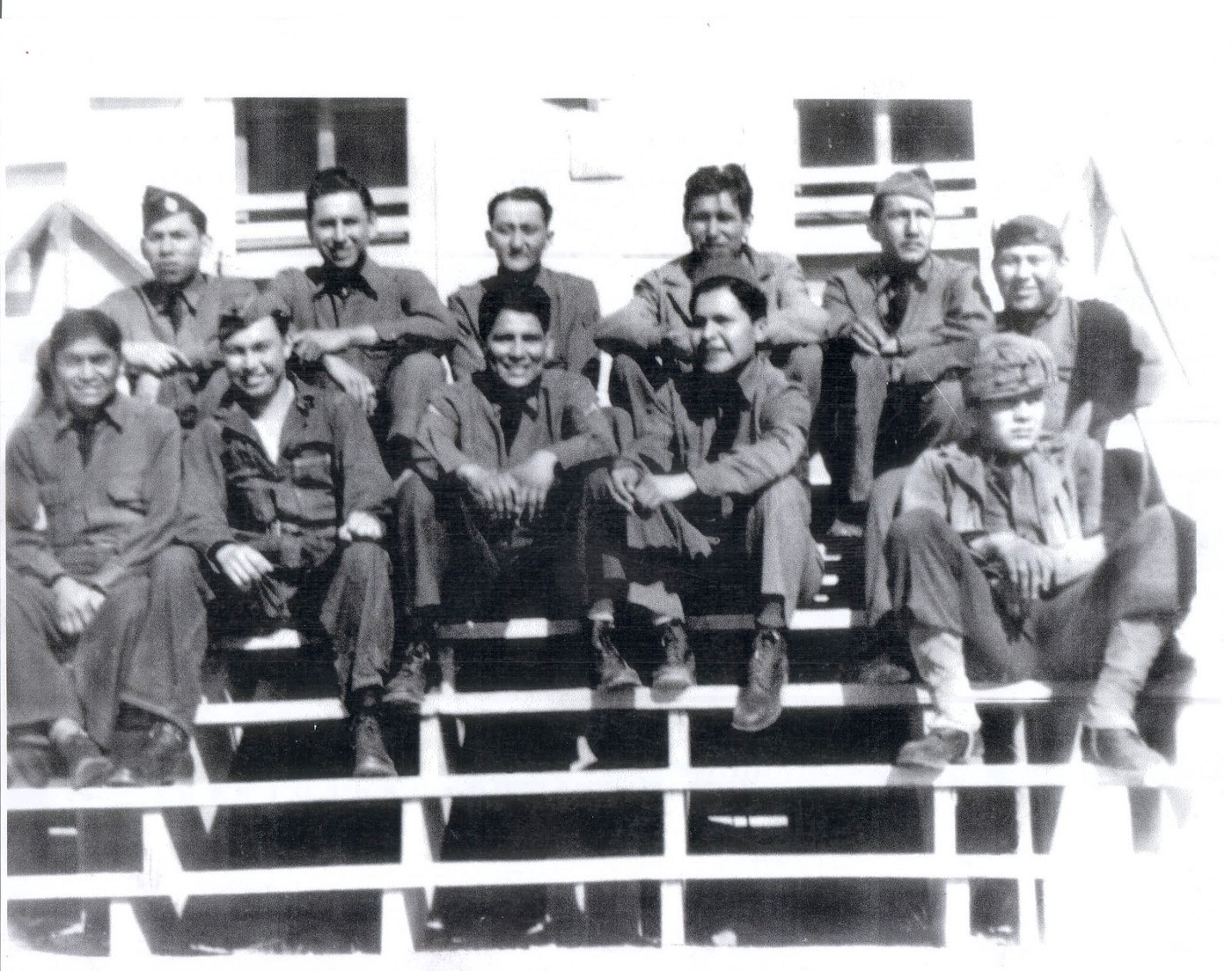A group of Comanche soldiers in uniform sitting for a photo