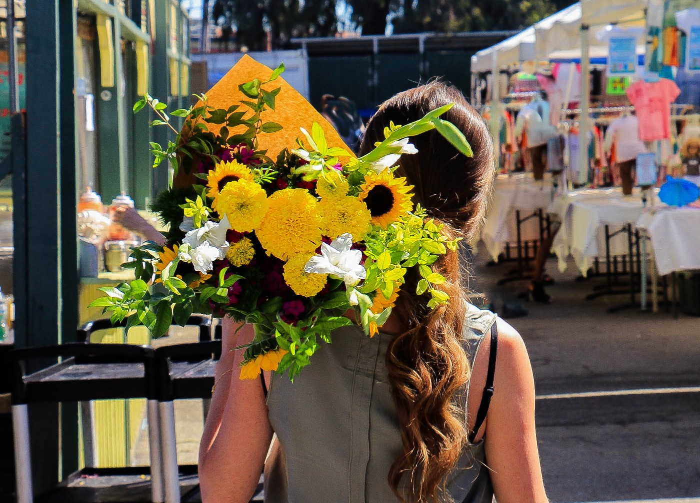 Woman holding a bouquet of flowers over her shoulder