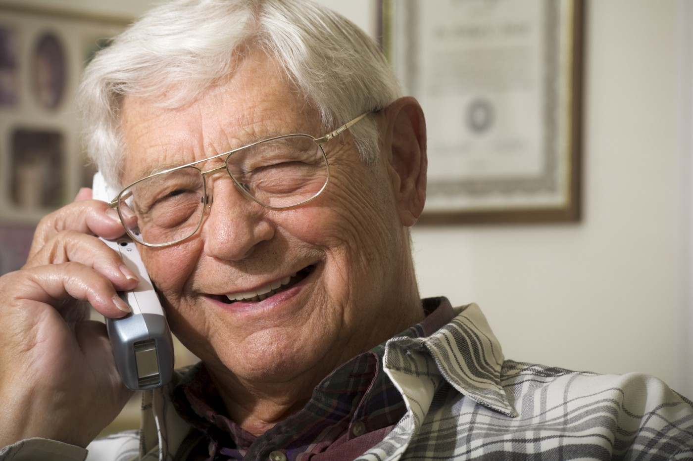 Smiling gentleman on the telephone, photo from Deafblind UK
