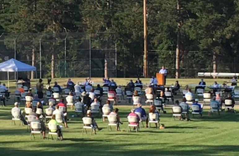 New England Town Meeting on baseball field during COVID-19 pandemic