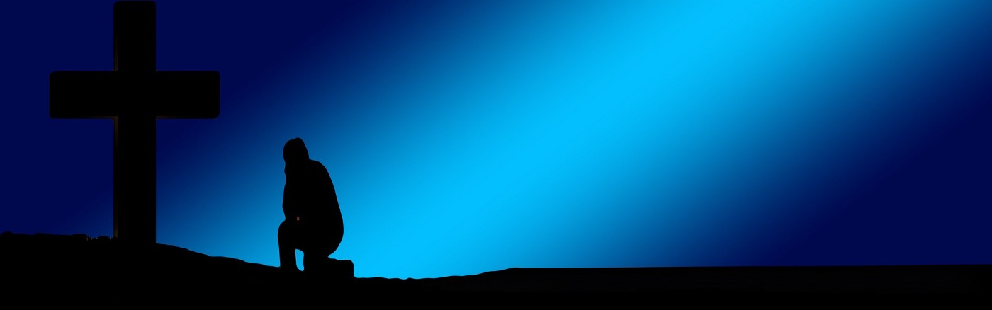 blue shading of a person kneeling before a shadowy cross