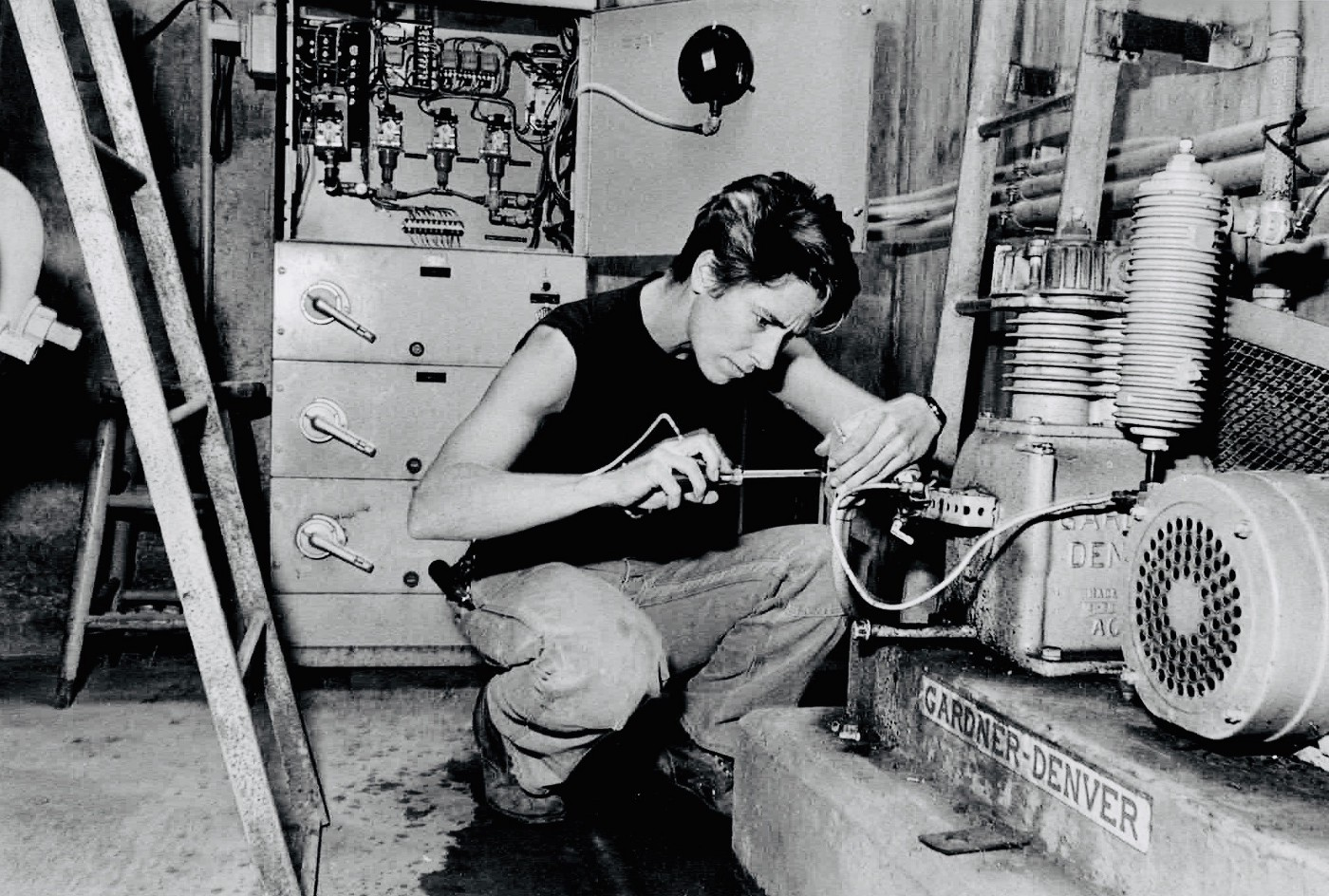 Black and white photo of the author in about 1985, working at a water department pump station.