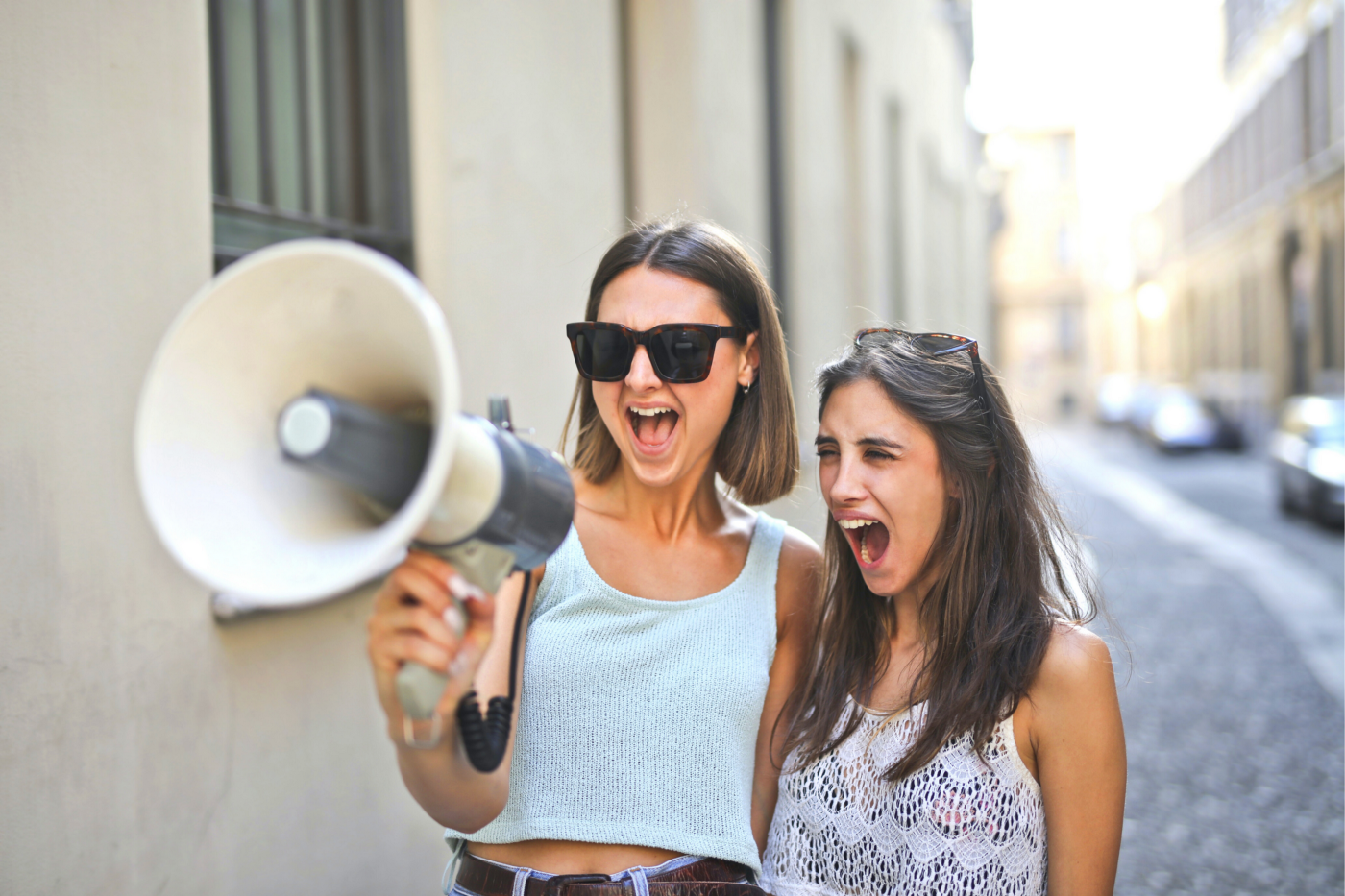 Two young girls with loudspeakers indicating the use of CTAs