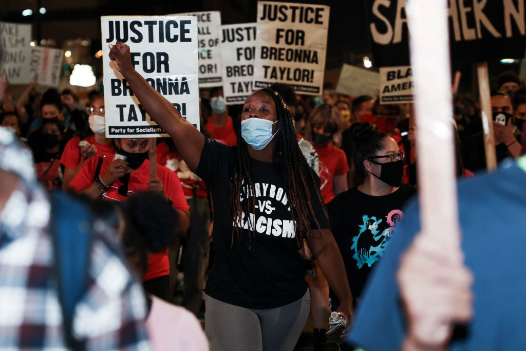 Black woman protesting the grand jury decision in Breonna Taylor's case.
