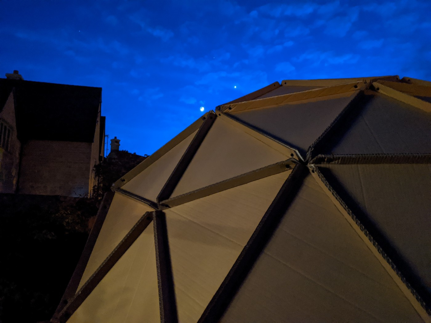 Cardboard dome with the moon and Venus visible in the sky