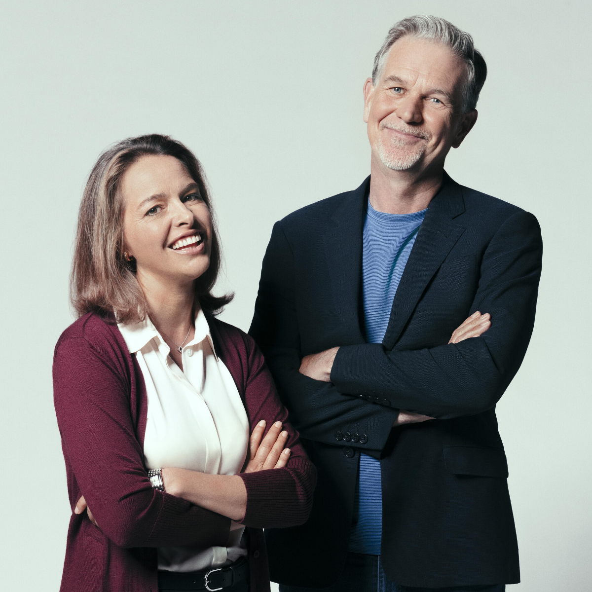 Erin Meyer and Reed Hastings, both in portrait, smiling to camera.