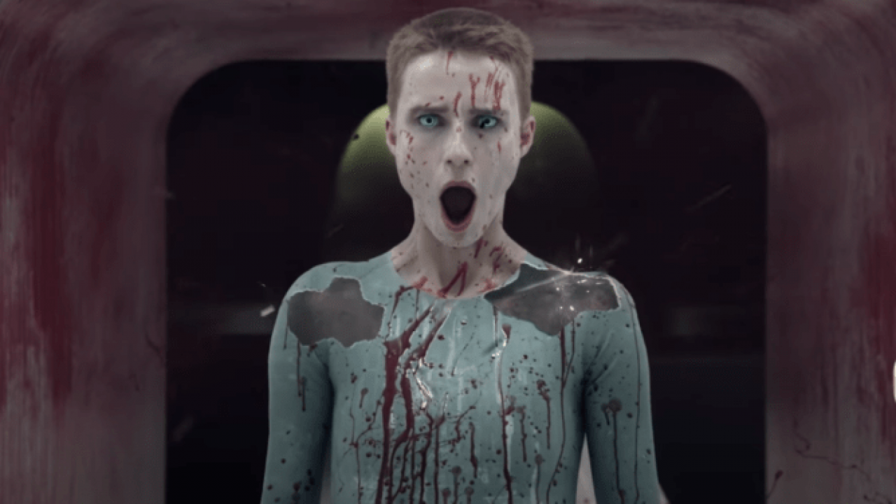 The character Mother (played by Amanda Collin) gasping, covered in rivulets of blood.