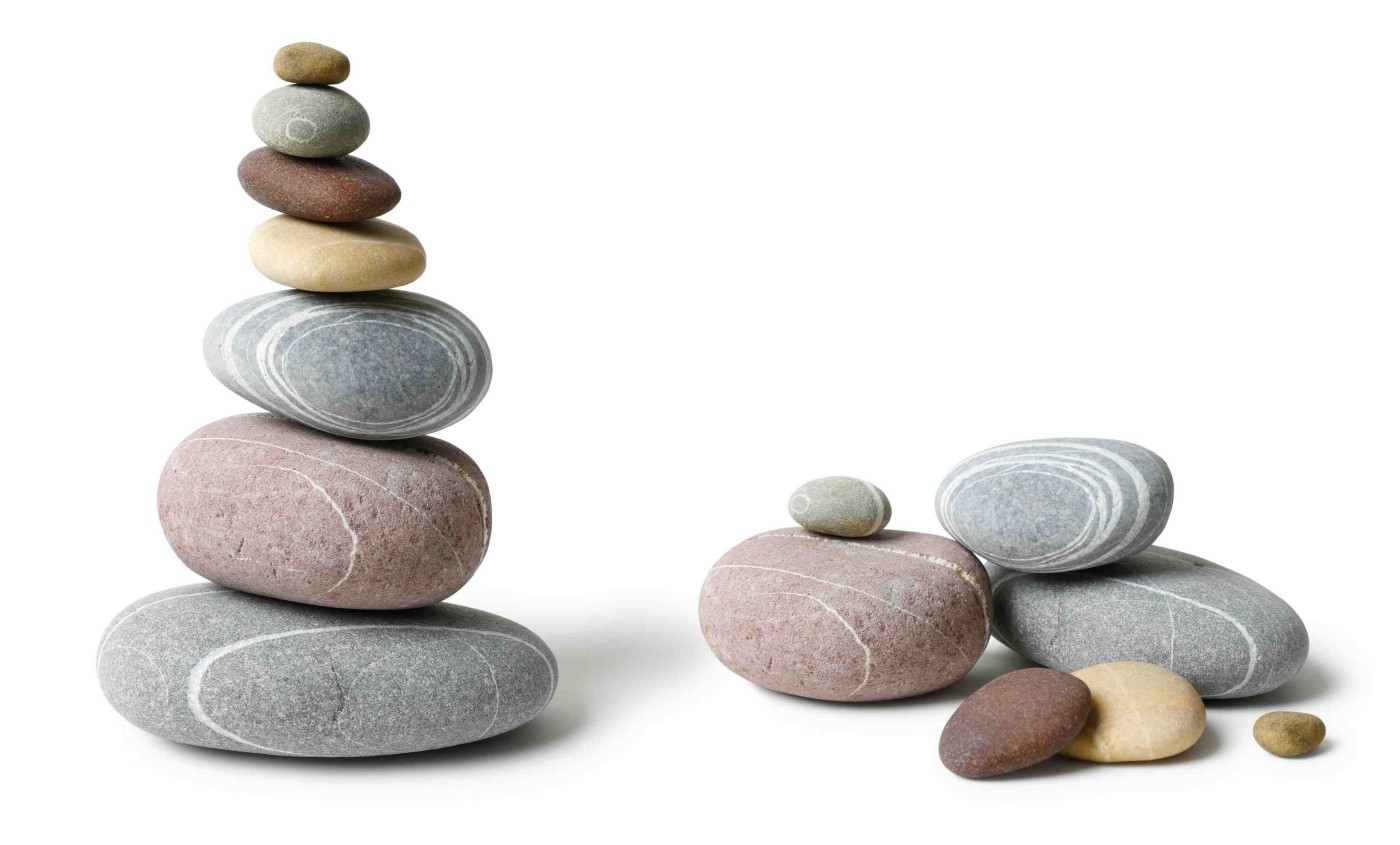 Balanced pyramid of pebbles and the identical stones collapsed next to it.