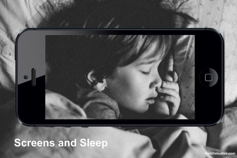 child sleeping within smartphone frame Screens and Sleep techdetoxbox.com