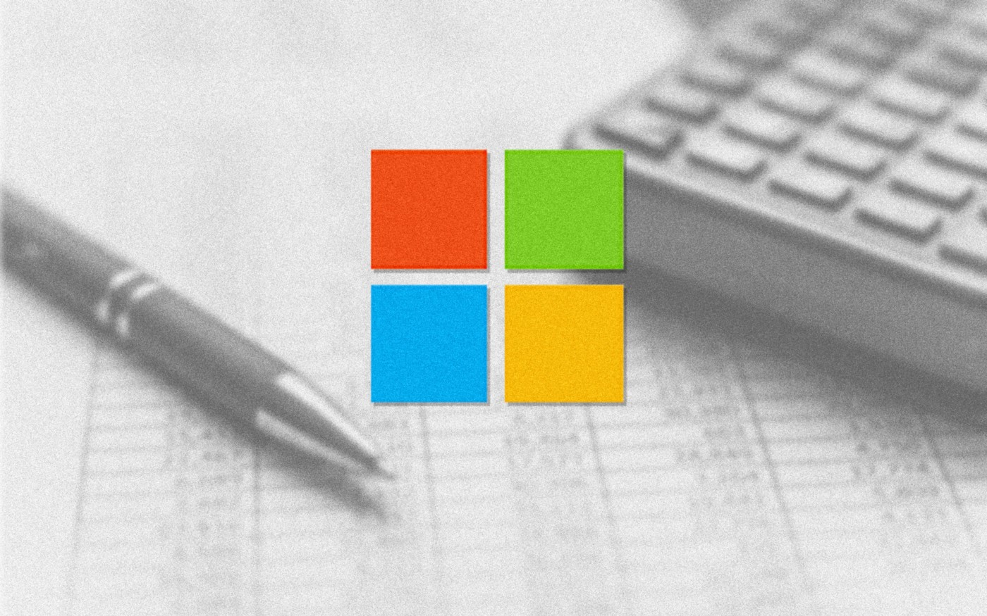 Microsoft logo over an image of a calculator, pen, and printed table chart.