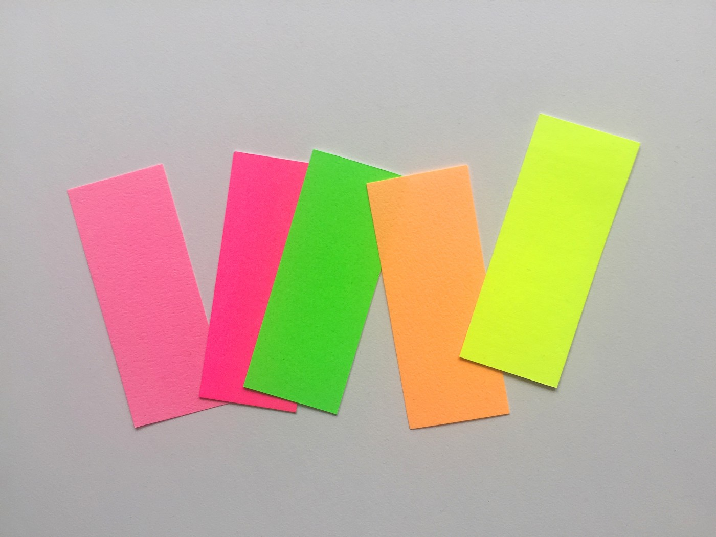 Main image displaying various fluorescent swatches: two pinks in different intensities, a green, an orange and a yellow.