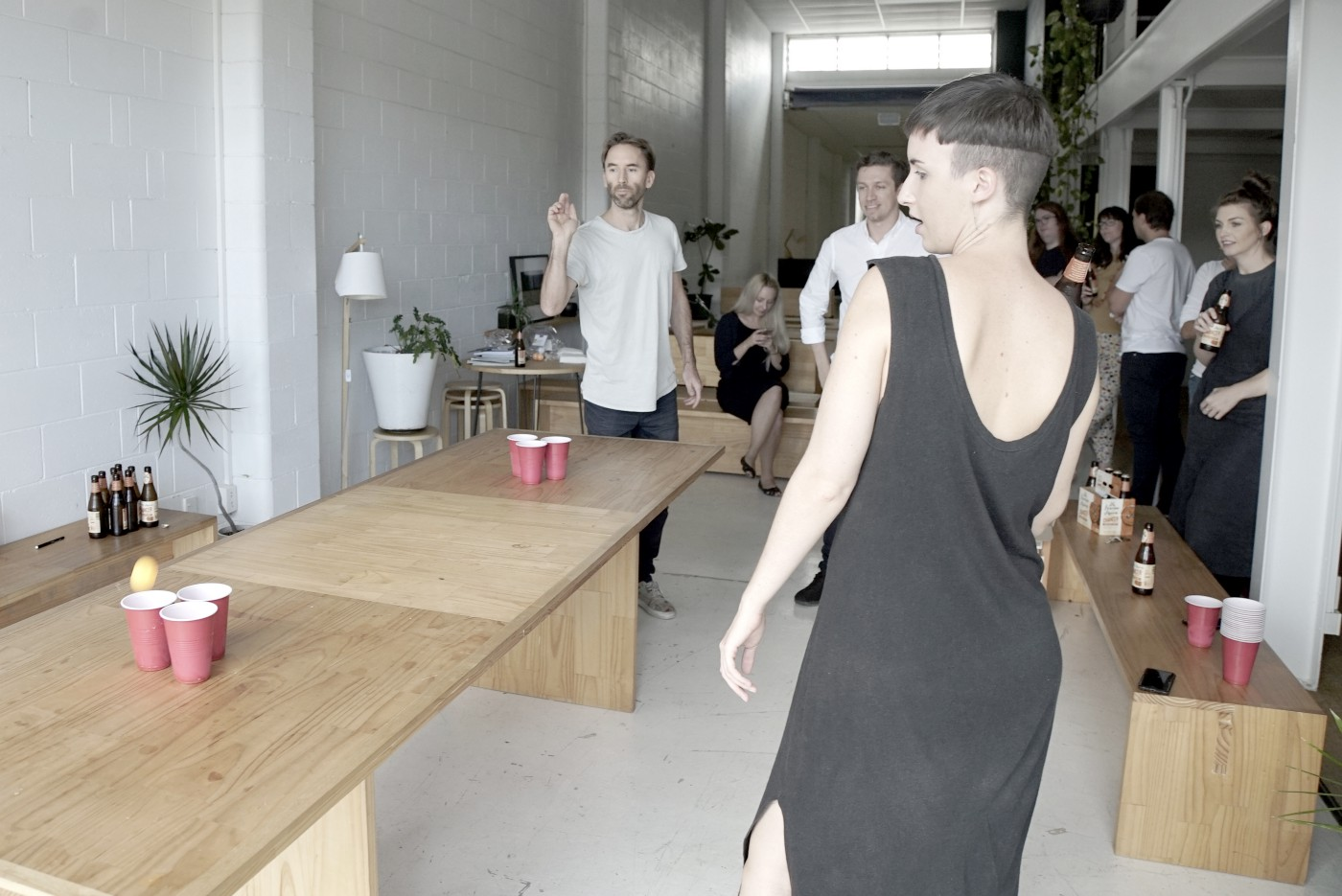 Matt playing beer pong with the team. You can see the slight blur of an orange ball about to land in the cup – he never misses, and it's INFURIATING.
