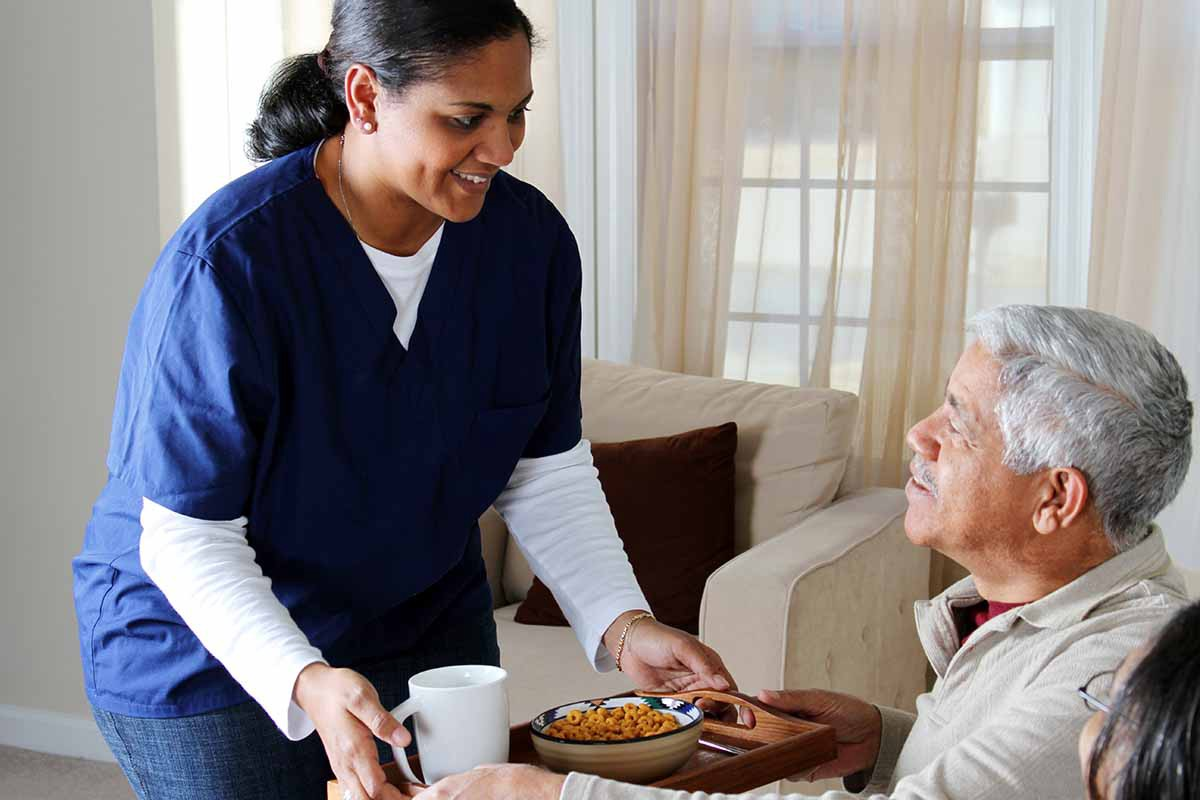 home healthcare worker with elderly man