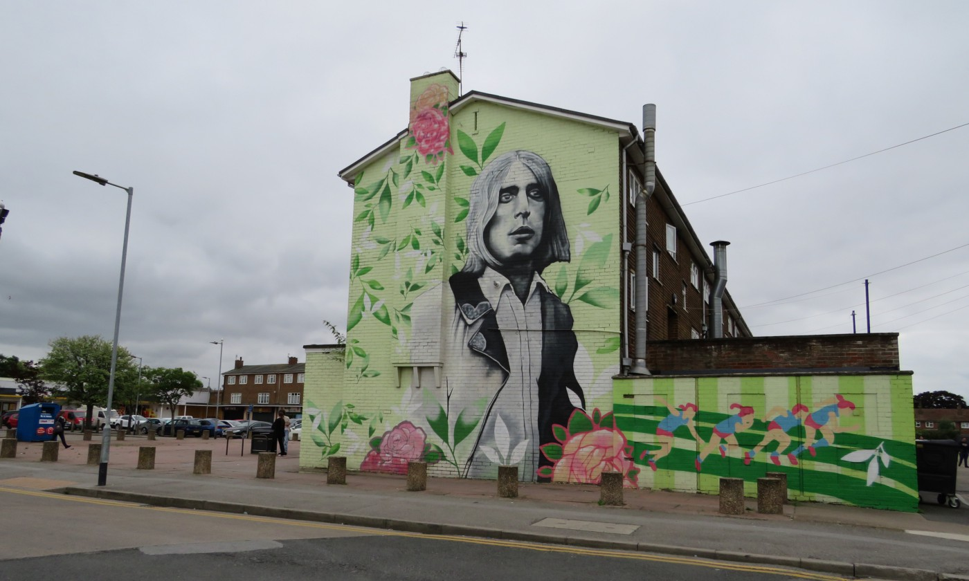Street mural of Mick Ronson, guitarist of The Spiders From Mars band (David Bowie) on side of building in Greenwich Avenue, Hull