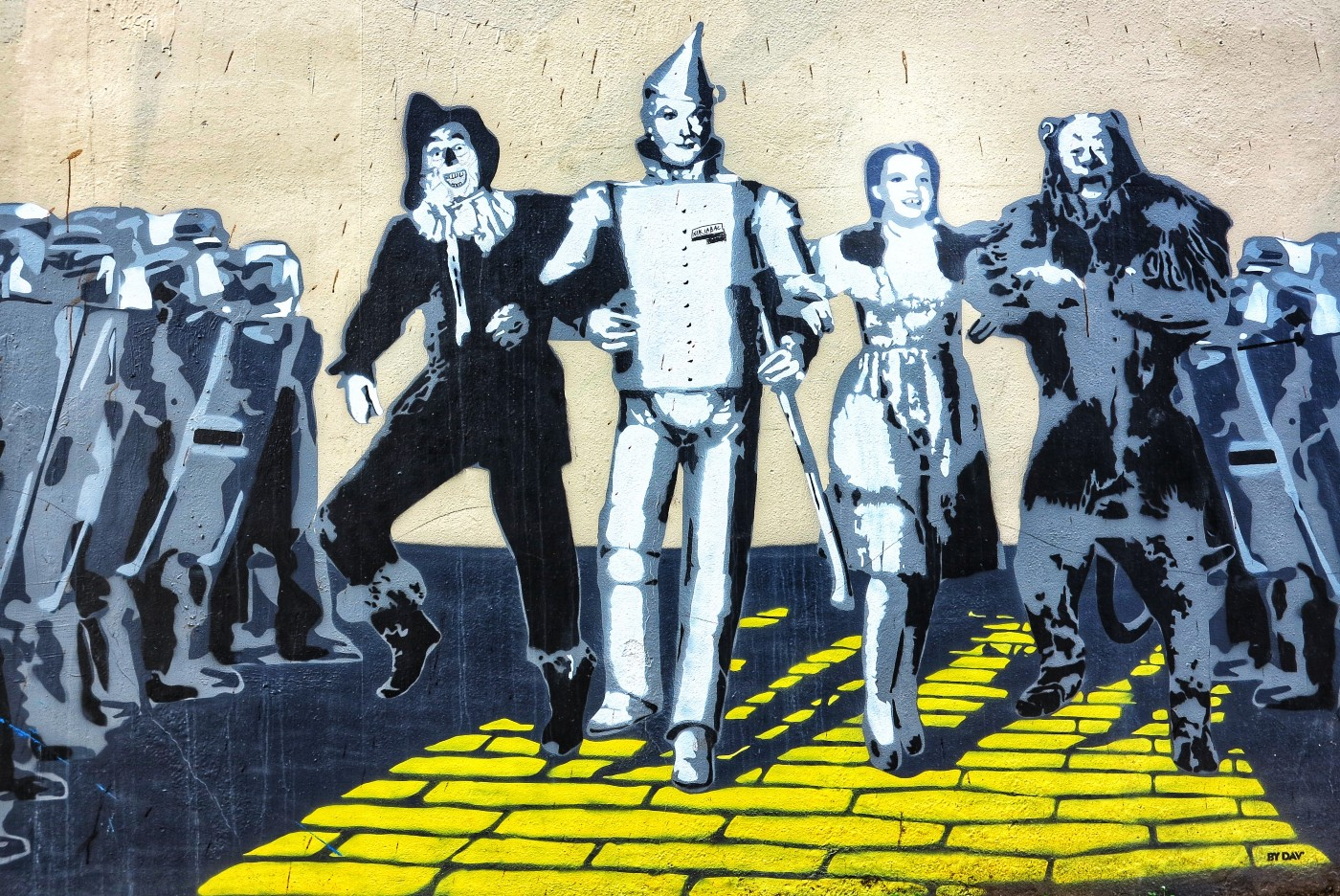 The Wizard of Oz characters marching on the yellow brick path