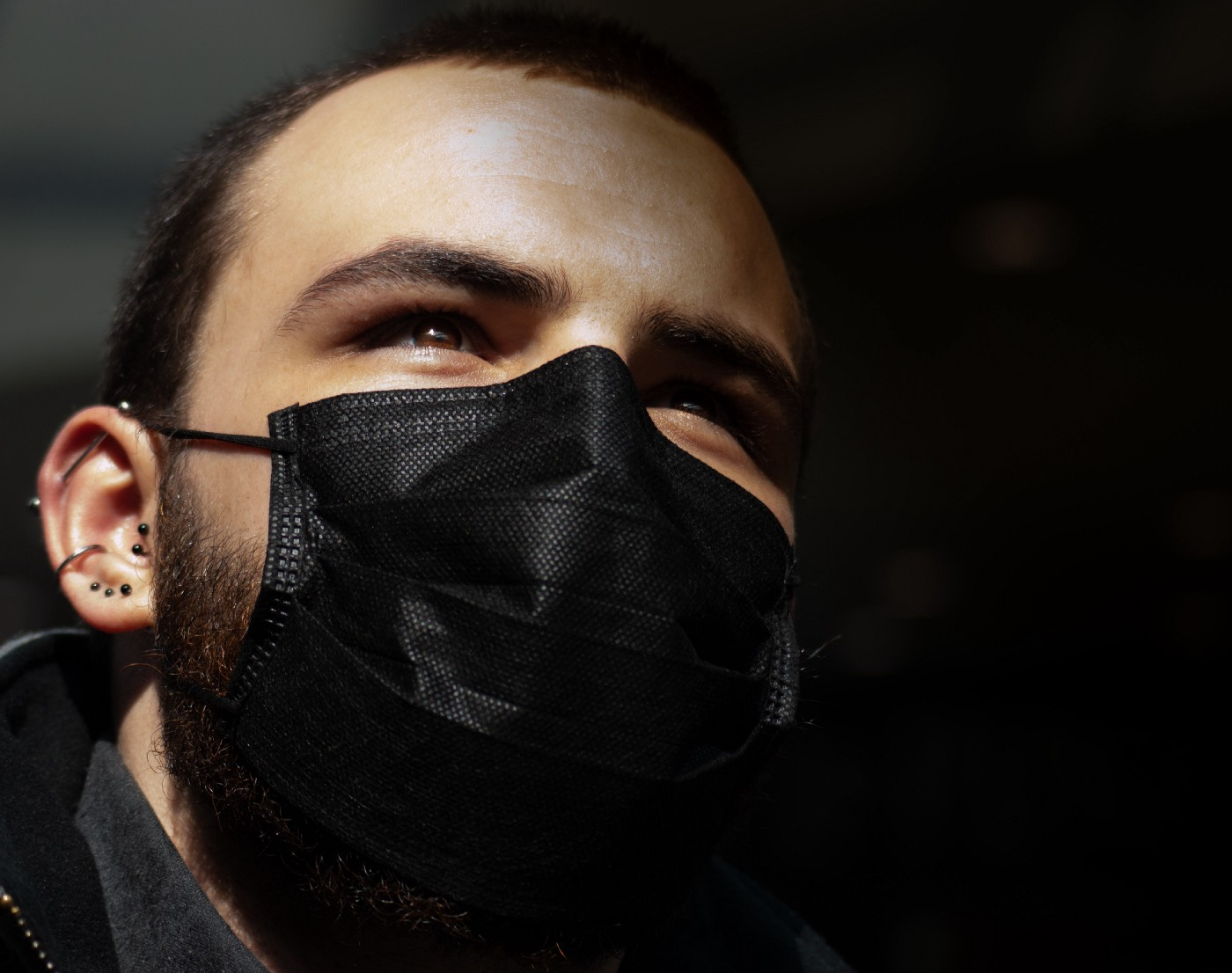 Black person wearing a black face mask