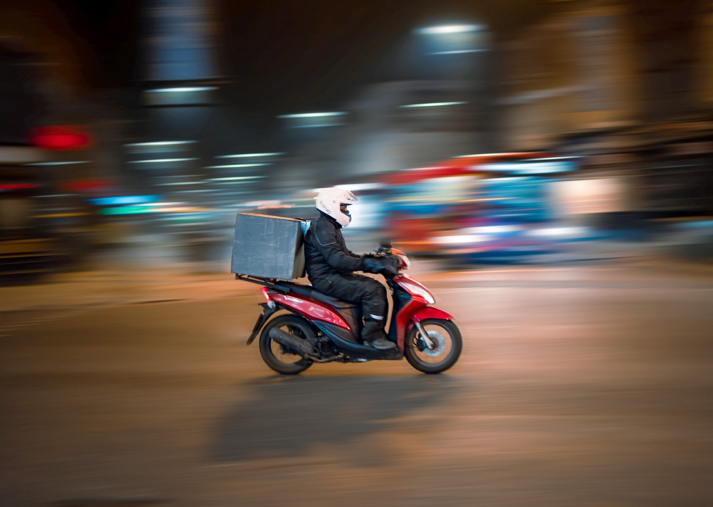 Man on a scooter doing food delivery
