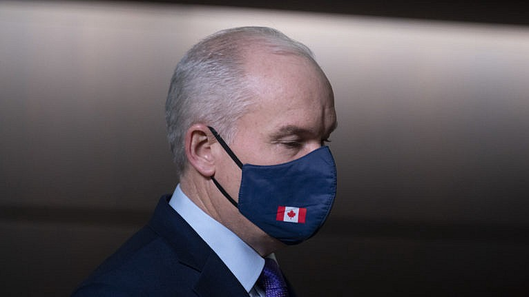 Canadian Conservative Party leader Erin O'Toole (he/him) wearing a face mask with a Canadian flag on it. Photo credit Adrian Wyld for Canadian Press