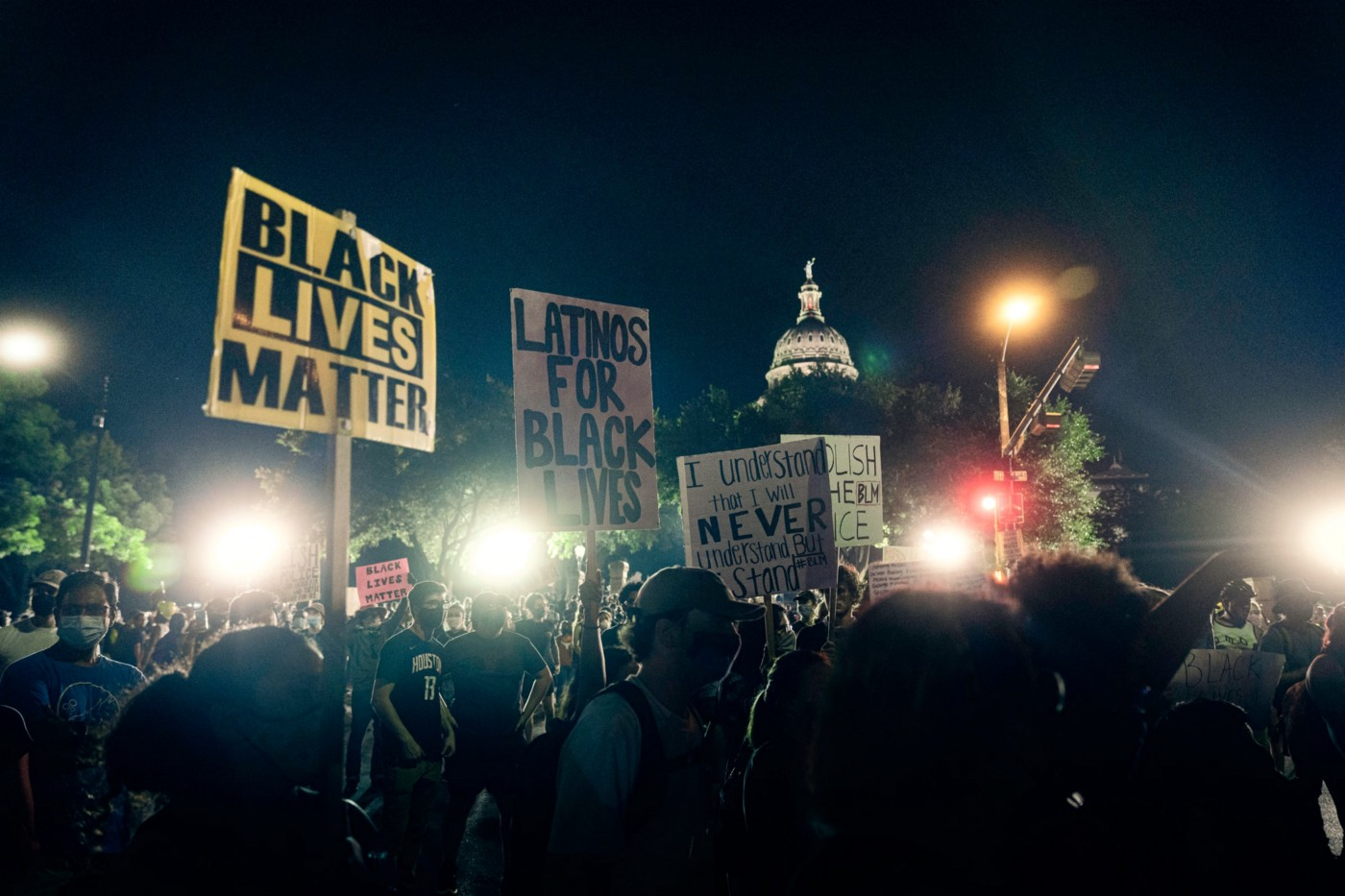 Photo taken at night of a group of Black Lives Matter protesters peacefully protesting