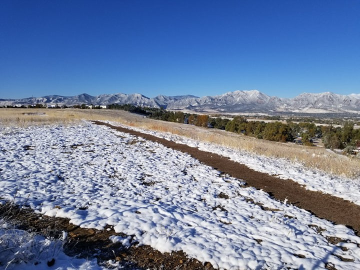 An unseasonably early dusting of snow on the Colorado mountains