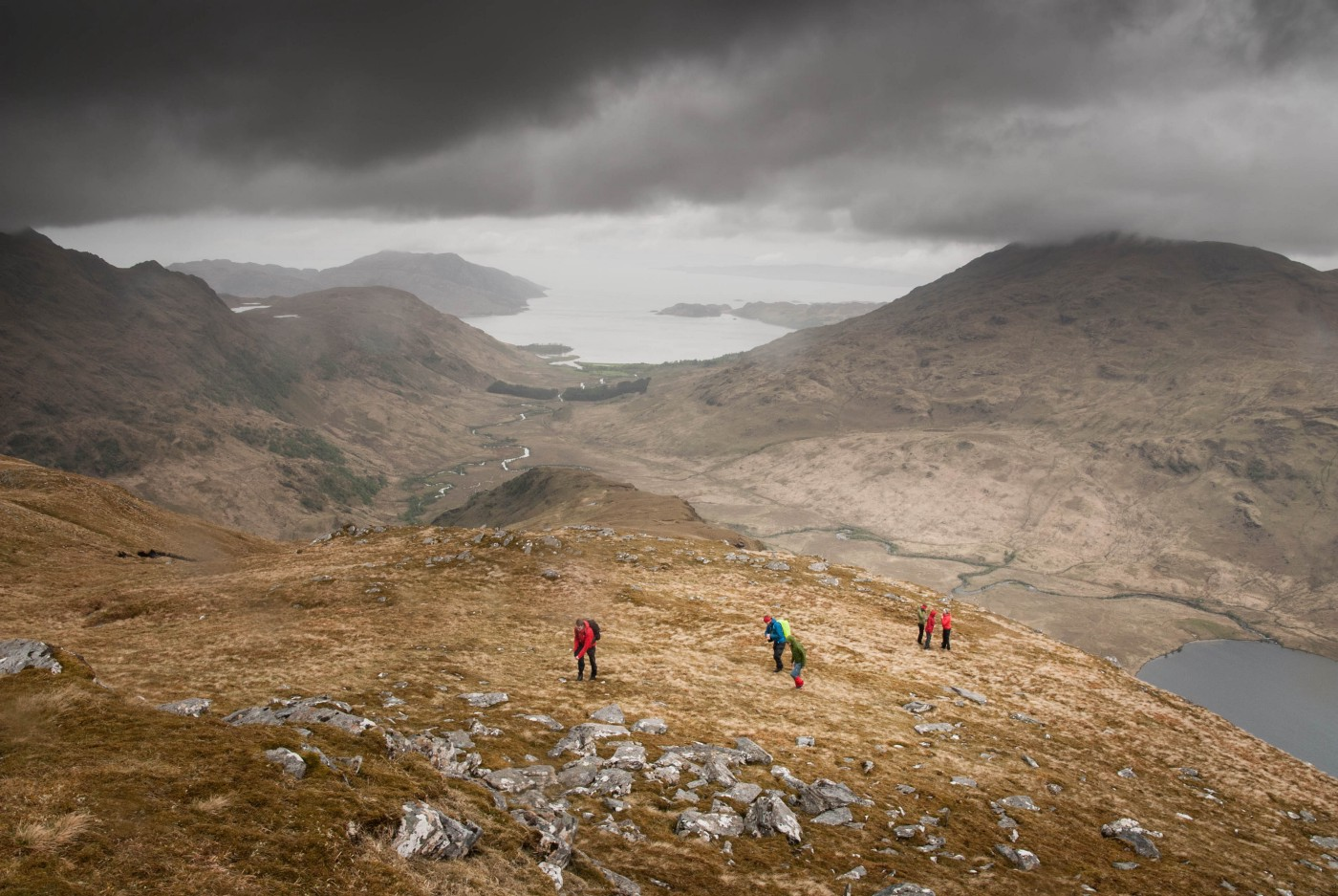 Aerial photo of hikers in a mountain. Photo by Kristóf Vizy on Unsplash.