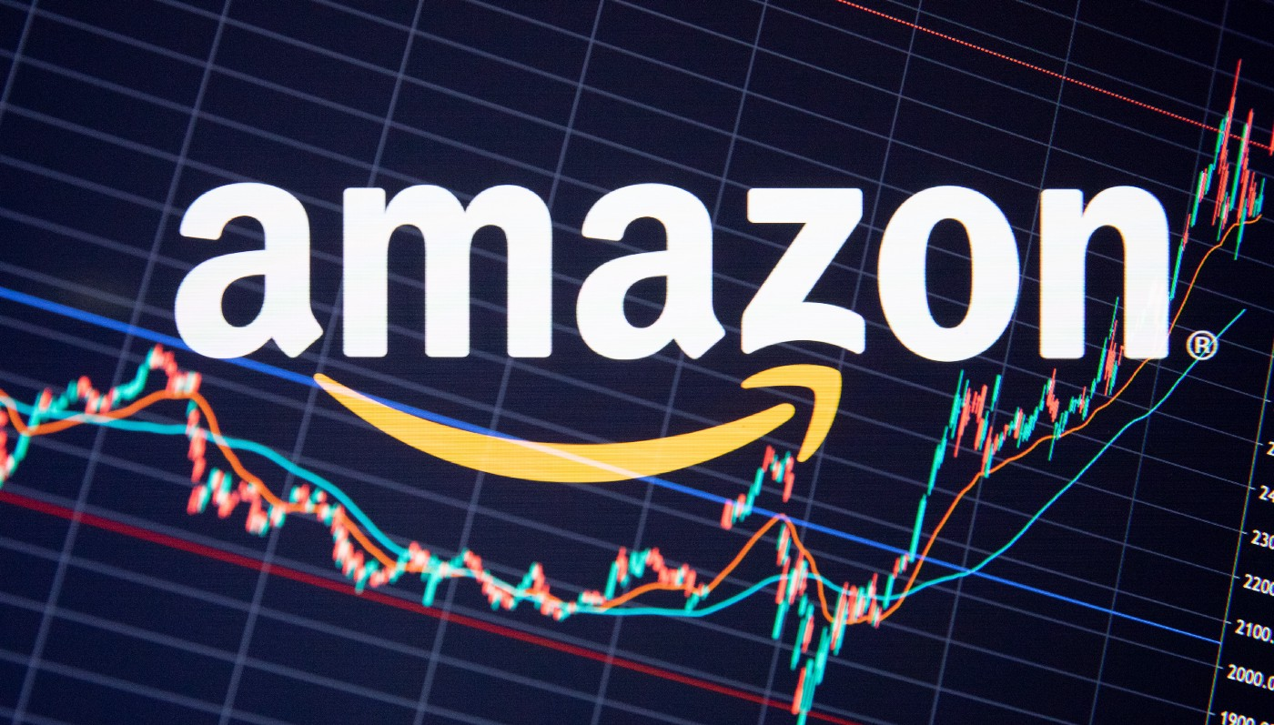 Multiple exposure photo of the Amazon logo juxtaposed over a generic stock chart.