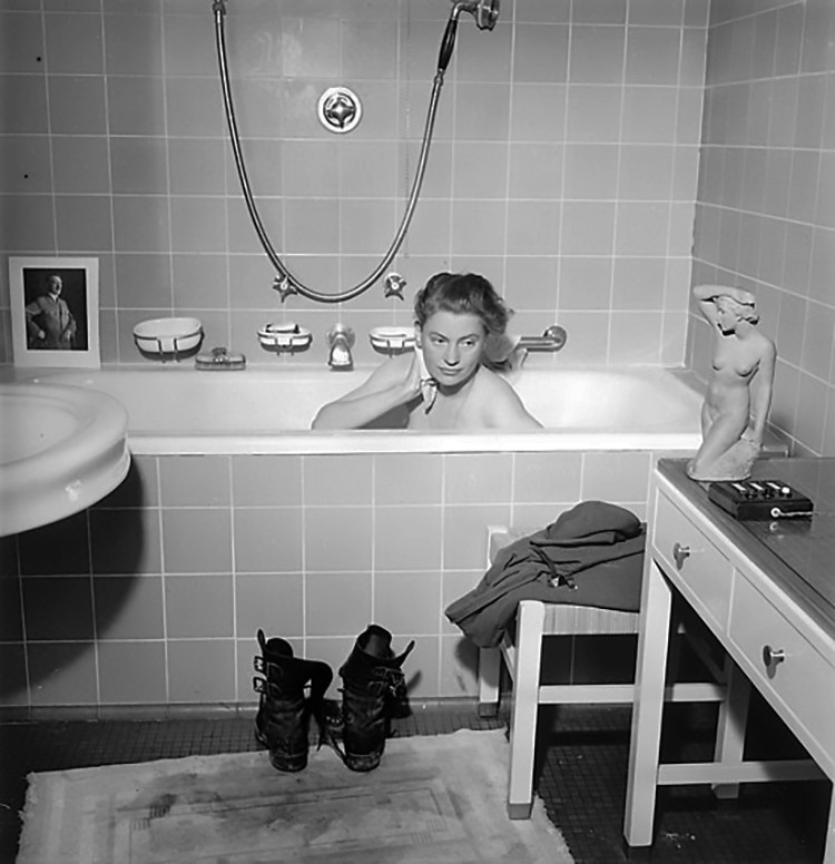 Archive photograph of Lee Miller bathing in Hitler's bath in Munich