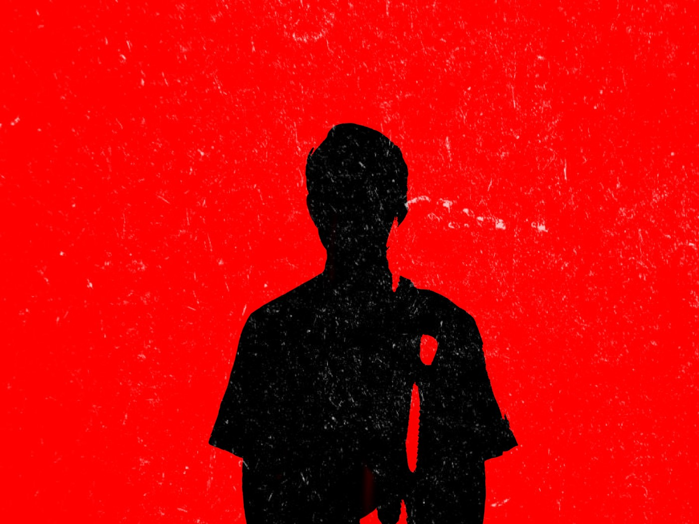 An illustration of a black silhouette of a young man against a bright red background.