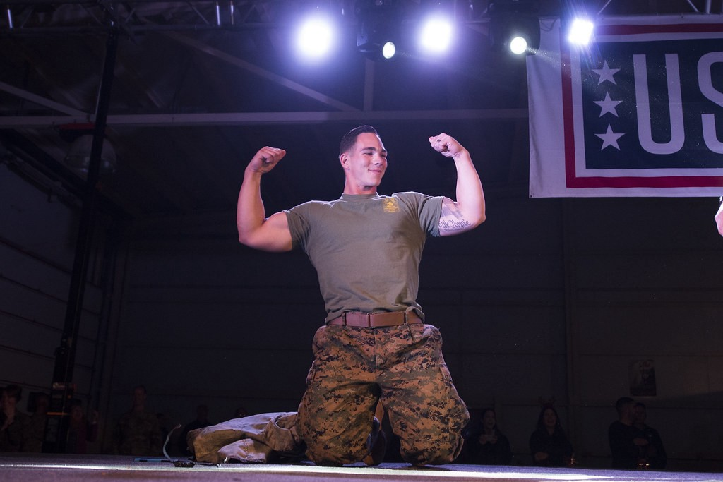 Body builder Marine on USO stage