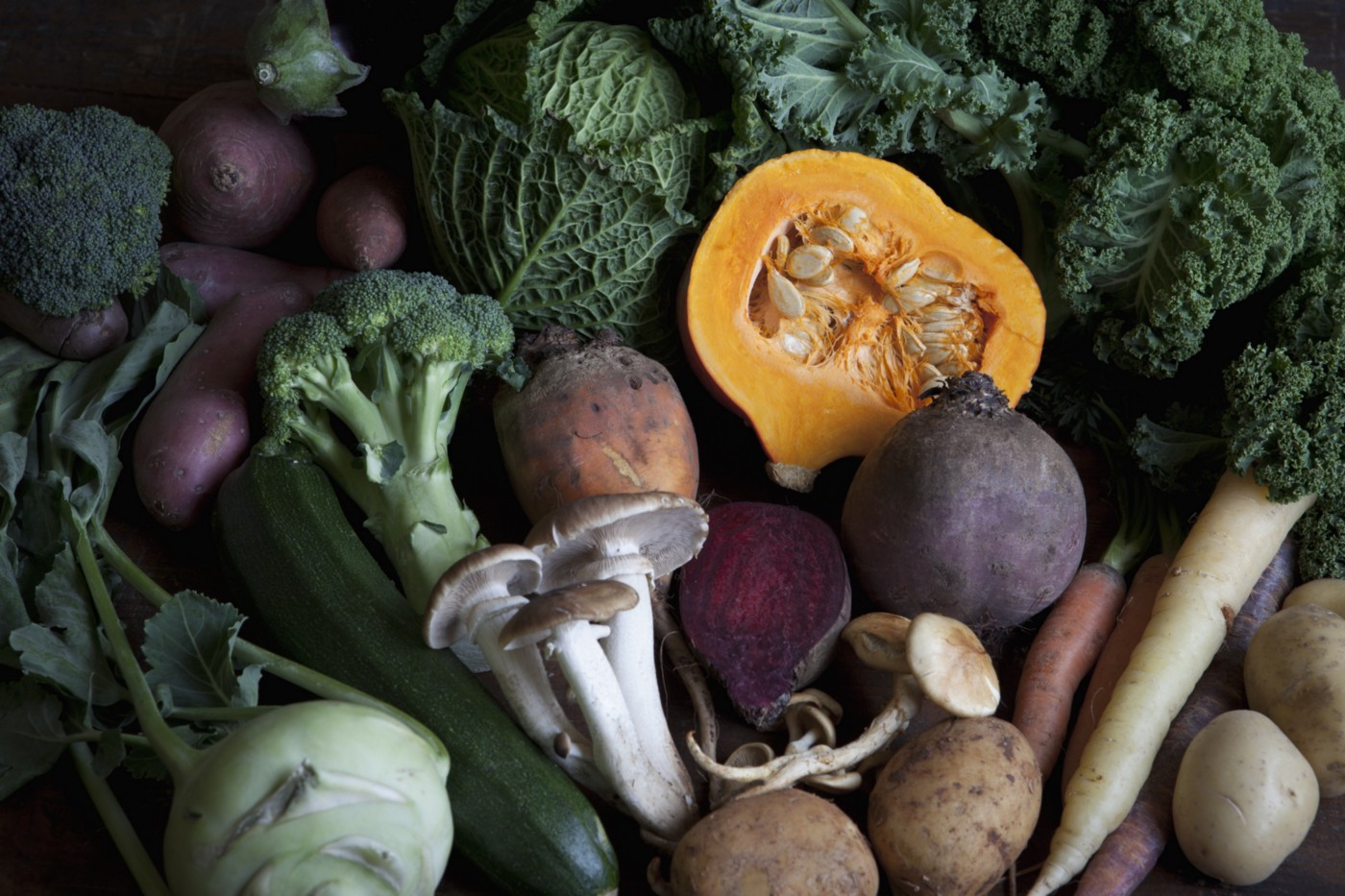 A bounty of fall vegetables like broccoli, parsnips, potatoes, mushrooms, and squash.