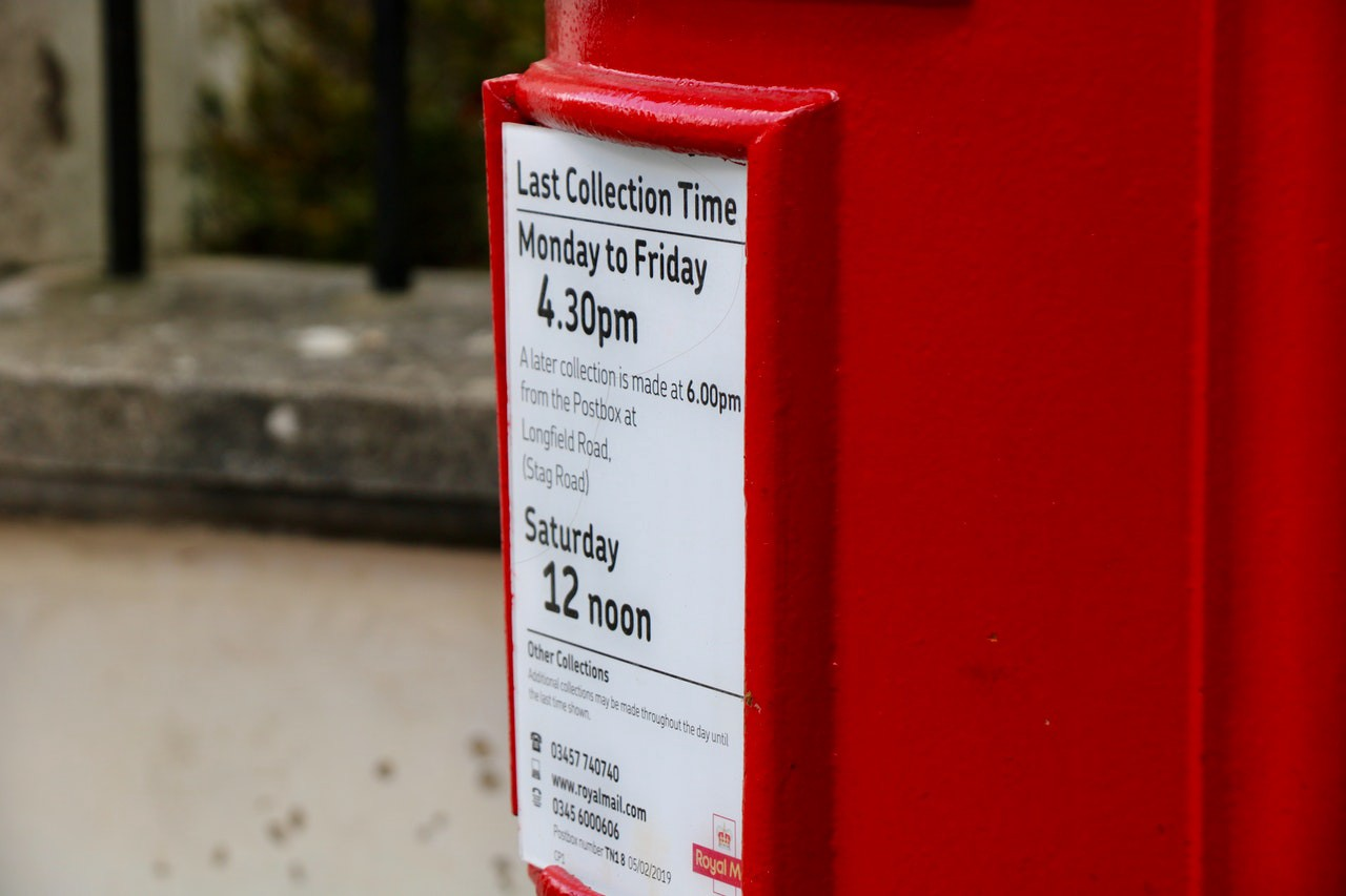 Red postal box with collection times listed