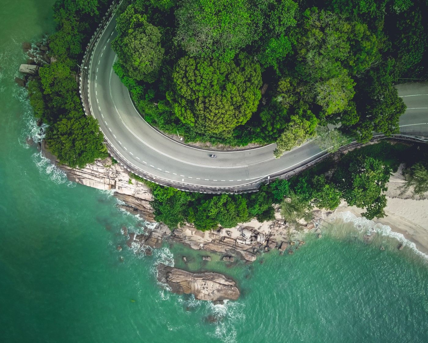 An aerial shot of a highway by the sea, Malaysia.