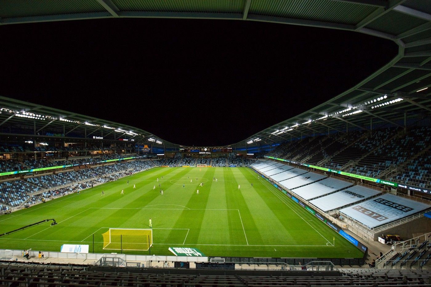 A picture of Allianz Field. A banner reading 'George Floyd, 8:46' is visible.