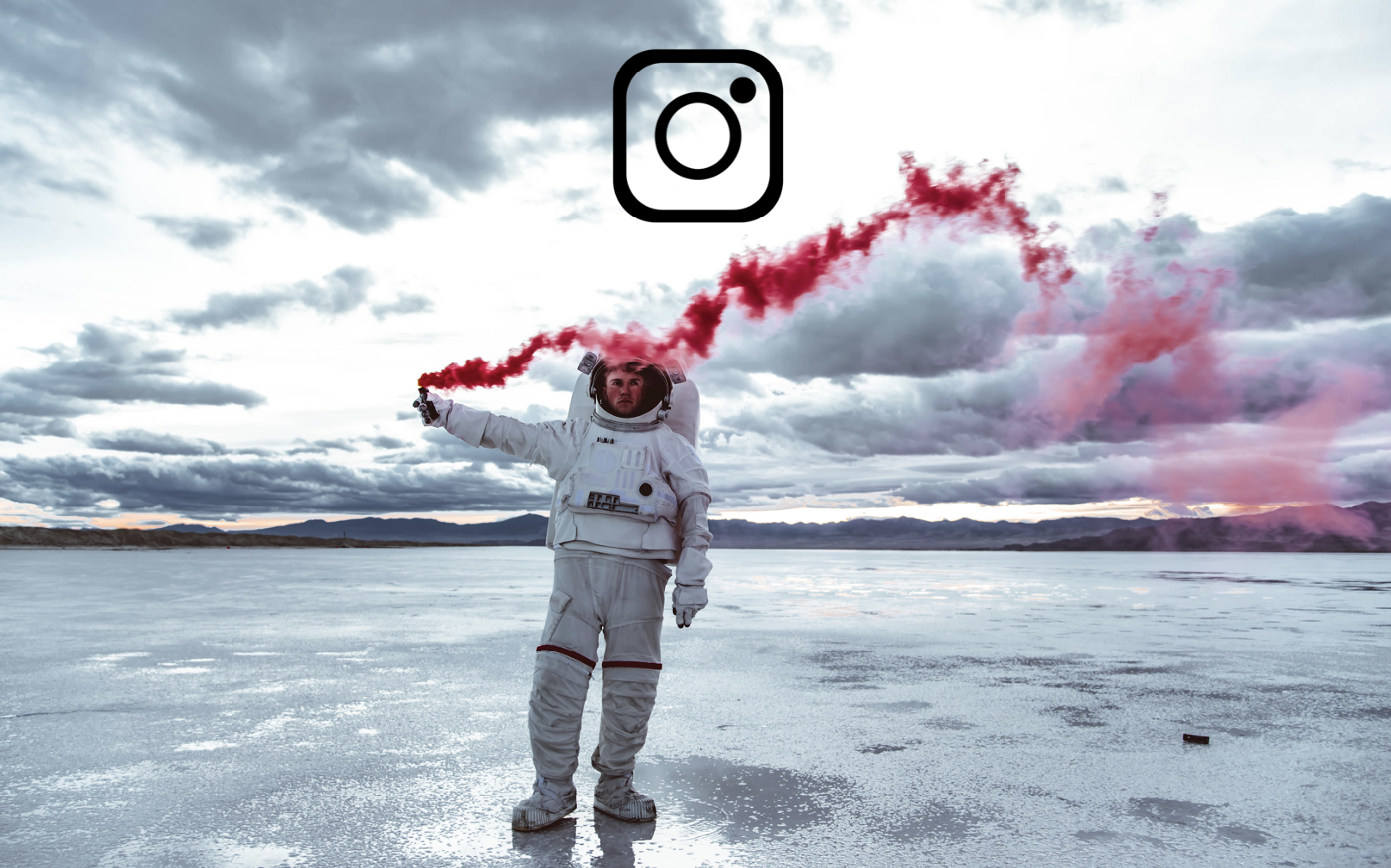 Man wearing a spacesuit holds a red smoke signal flare while standing in a frozen tundra.